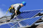 solar installer (photo Greens MPs)