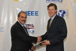 David Arfin with Rhone Resch, President of Solar Energy Industries Association (SEIA), being awarded the first ever Innovations in Solar Finance award.